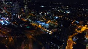 Skyline of Atlanta Downtown by night, freeway with interchanges, traffic headlights in realtime. Georgia stock video