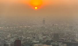 Skyline of Bangkok in sunset with smog and dust Royalty Free Stock Images