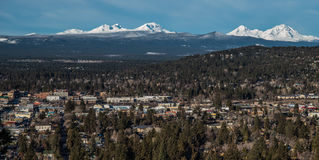 Skyline of Bend Oregon with Cascade Mountains. Snow-capped mountains of the Cascade Range and the city of Bend Oregon stock image