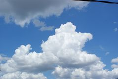Skyline with Bright Blue Sky and Some White Clouds and One Gray Cloud. SONY DSC This is A Skyline with Bright Blue Sky and Many WhiteClouds and 1 Gray Clouds royalty free stock photos