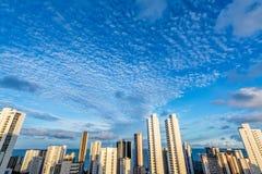 Skyline Buildings in a Blue Sky day at Boa Viagem Beach, Recife, Pernambuco, Brazil. Skyline Buildings in a Blue Sky with beautiful clouds at Boa Viagem Beach royalty free stock images