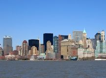 Skyline of buildings in New York against blue sky. stock photos
