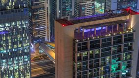 Skyline of the buildings of Sheikh Zayed Road and DIFC aerial night timelapse in Dubai, UAE. Skyline of the buildings near Sheikh Zayed Road and DIFC aerial stock footage