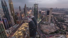 Skyline of the buildings of Sheikh Zayed Road and DIFC aerial night timelapse in Dubai, UAE. Panoramic skyline of the buildings near Sheikh Zayed Road and DIFC stock video footage