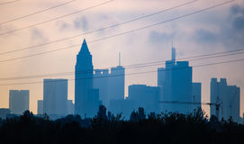 Skyline of business buildings at sunrise in Frankfurt, Germany. Skyline of office buildings at sunrise in Frankfurt, Germany, one of the most fascinating Royalty Free Stock Photo