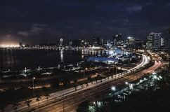 Skyline of capital city Luanda and its seaside during the night, Angola, Africa.  stock images