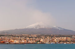 Skyline of Catania with snowy volcano Etna in background Stock Image