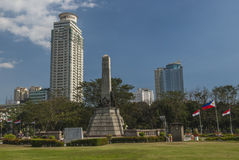 Skyline of Central Manila seen from Rizal Park Royalty Free Stock Photo