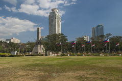 Skyline of Central Manila seen from Rizal Park Royalty Free Stock Images