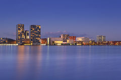 Skyline of the city of Almere in The Netherlands. The skyline of the city of Almere in The Netherlands, photographed from across the water at dusk royalty free stock image