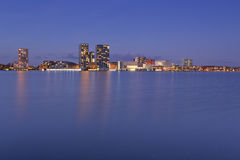 Skyline of the city of Almere in The Netherlands. The skyline of the city of Almere in The Netherlands, photographed from across the water at dusk royalty free stock photos
