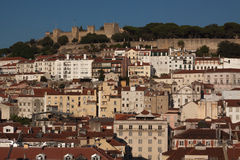 Skyline of the city of Lisboa at dusk, with lit. Landscape of the city of Lisbon at dusk, red roofs and white facades and dark blue sky Stock Photo