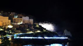 White fireworks in the skyline of the city Sperlonga in Italy royalty free stock photo