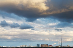 Skyline with clouds in dark blue evening sky Royalty Free Stock Image