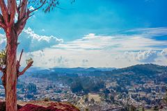Skyline of Coimbatore city from Ooty view point with beautiful sky formation, Ooty, India, 19 Aug 2016. Skyline of Coimbatore city from Ooty view point with Royalty Free Stock Images