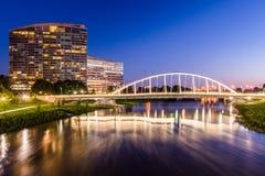 Skyline of Columbus, Ohio from Bicentennial Park bridge at Night Stock Photo
