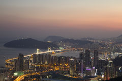 Skyline da cidade de Busan no por do sol Foto de Stock Royalty Free