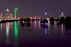 Skyline of Dallas, Texas at Night across Flooded Trinity River Royalty Free Stock Images