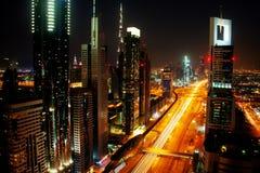 Skyline de Dubai na noite Imagens de Stock