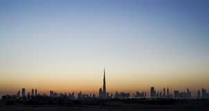 Skyline de Dubai no por do sol Fotos de Stock Royalty Free