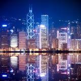 Skyline de Hong Kong na noite Fotografia de Stock