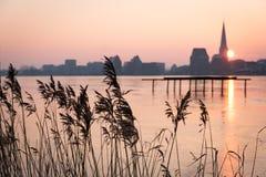 Skyline de Rostock no nascer do sol Foto de Stock Royalty Free