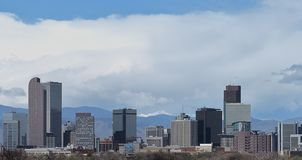 The skyline of Denver, Colorado, with Rocky Mountains in the distance stock photo