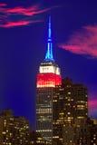 Skyline do por do sol de Manhattan New York do leste Fotos de Stock