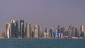 Skyline of Doha night to day transition timelapse in Qatar. Skyline of the arabian city of Doha night to day transition timelapse in Qatar, captured in the very stock video footage