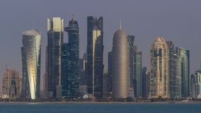 Skyline of Doha night to day transition timelapse in Qatar. Skyline of the arabian city of Doha night to day transition timelapse in Qatar, captured in the very stock footage
