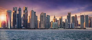 The skyline of Doha. Qatar, on a cloudy sunset Royalty Free Stock Photos