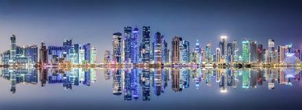 The skyline of Doha, Qatar, at night Stock Image