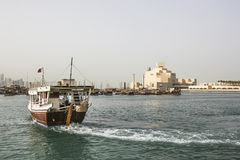 Skyline of Doha with traditional arabic dhows Royalty Free Stock Photos