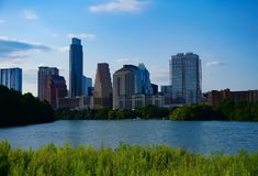 The skyline of downtown Austin Texas from the boardwalk on Lady Bird Lake. A look at the city skyline of downtown Austin Texas from the boardwalk on Lady Bird stock photography