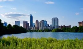 The skyline of downtown Austin Texas from the boardwalk on Lady Bird Lake. A look at the city skyline of downtown Austin Texas from the boardwalk on Lady Bird stock image