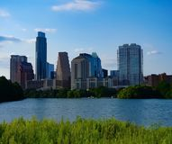 The skyline of downtown Austin Texas from the boardwalk on Lady Bird Lake. A look at the city skyline of downtown Austin Texas from the boardwalk on Lady Bird royalty free stock photography