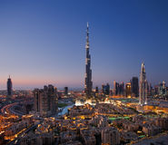 A skyline of Downtown Dubai with Burj Khalifa and. A skyline view of Downtown Dubai, showing the Burj Khalifa and Dubai Fountain