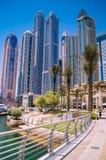 Skyline of Dubai at the marina with blue sky. royalty free stock photography