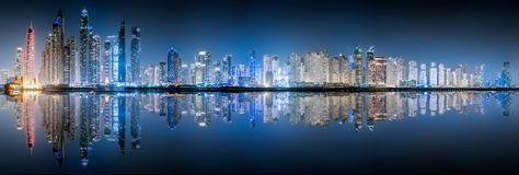 The skyline of Dubai Marina by night. The illuminated skyline of Dubai Marina by night royalty free stock photo