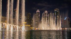 The skyline of Dubai at night as a night shot royalty free stock photography