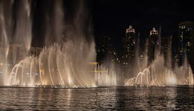 The skyline of Dubai at night as a night shot royalty free stock images