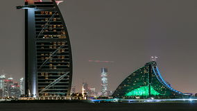 Skyline of Dubai at night timelapse with Burj al Arab in foreground in Dubai, United Arab Emirates stock video