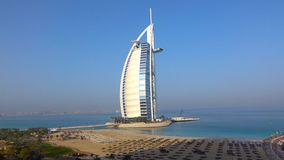 Skyline of Dubai from the water //The world`s first seven stars luxury hotel Burj Al Arab stock images
