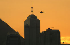 Skyline at Dusk. Close-up of Hong Kong skyline (skyscrapers in Central) with helicopter flying past Royalty Free Stock Photo