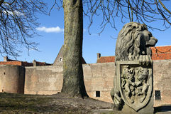 Skyline of Elburg with city wall and sculpture of lion. Netherlands,  province Gelderland, Veluwe, city, small town, fortified and Hanseatic city Elburg: in the Royalty Free Stock Image
