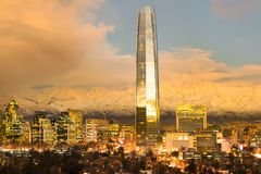 Skyline of financial district in Las Condes with The Andes Mountains in the back, Santiago Stock Photo