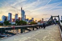 Skyline of Frankfurt am Main. With sunset and the footbridge Eiserner Steg in the foreground, done in HDR technique Royalty Free Stock Images