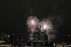 Fireworks over skyscrapers at night Stock Photography