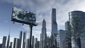 Skyline of a futuristic city with a video screen. An 3D rendered image of a skyline of a modern futuristic city. Modern buildings, skyscrapers and office Royalty Free Stock Image