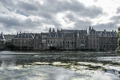 Skyline of The Hague with the modern office buildings behind the Mauritshuis museum and the Binnenhof parliament building next to royalty free stock photography